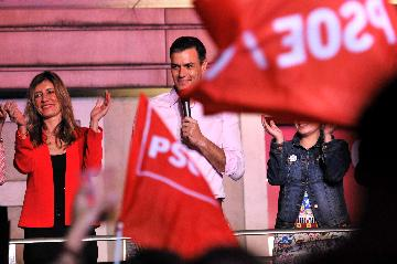 Spanish PM claims victory after his party takes lead in general election