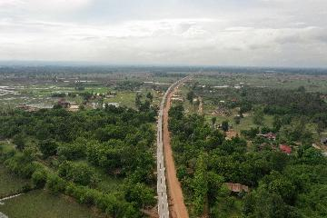 China, Laos to boost cooperation on road, bridge construction