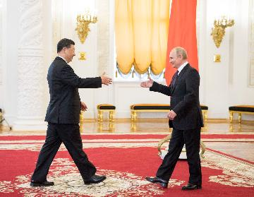 Feature: Xi and Putin -- at helm of China-Russia relations
