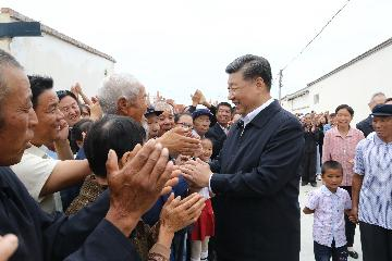 Xi highlights poverty, environmental protection