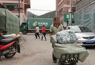 Chinas postal sector sees remarkable progress over 70 years