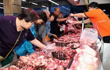 Chinas pork imports surge in first three quarters