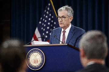 財經觀察:美聯儲年內第三次降息 暗示將轉向觀望