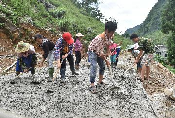 China to connect all townships, villages with paved roads by end-2019