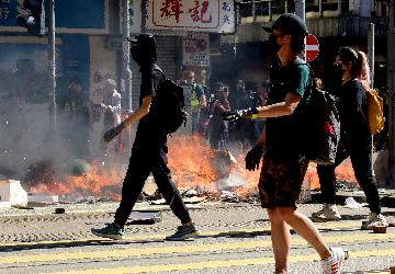 Rioters wreak havoc in Hong Kong, traffic paralyzed, man set on fire