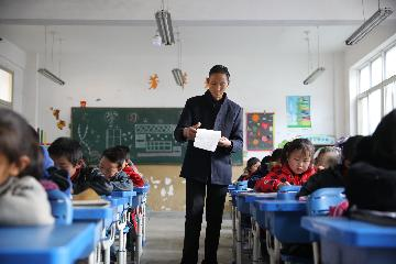 Report highlights progress in Chinas education system