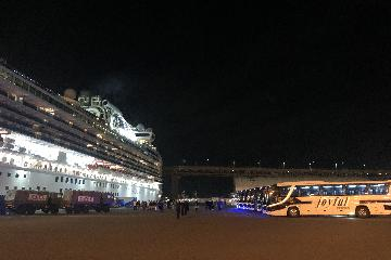 Passengers start disembarking from virus-hit Diamond Princess in Japan