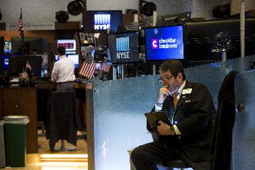Dow drops over 300 points on first trading day of 2021