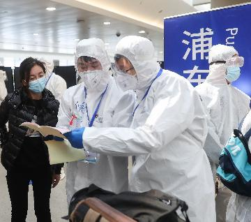 Shanghai lowers coronavirus response level