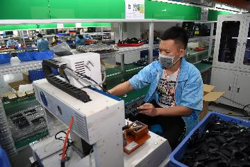 Chinese firms see improving business climate in Q2