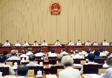China revises law to facilitate use of patents