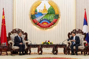 Laos, China vow to further enhance ties, cooperation
