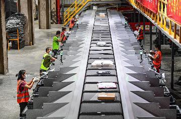 """""""雙十一""""綠色升級:百億包裹背後的減碳行動"""