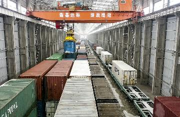 Xinjiangs Alataw Pass reports growing China-Europe freight train trips