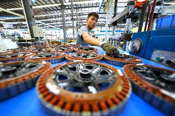 China improves business environment, provides foreign investors with larger markets: white paper